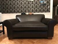 Comfy brown leather loveseat/sofa