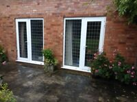 2 sets of UPVC doors and windows