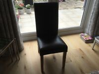 Six leather high backed dining chairs