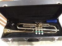 Earlham student trumpet and case