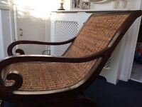 """Colonial style """"banana""""whicker chair with a few minor scratches and scuffs which adds character"""