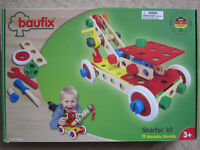 Wooden building set with nuts and bolts