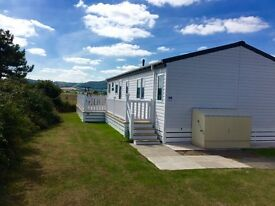 USED 2016 LODGE SITED WITH DECKING INCLUDED CONWY
