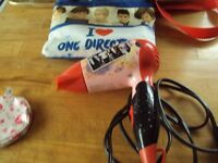 girls hair dyer , in bag , with group one direction on it ,