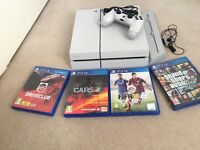 SONY PlayStation 4 500GB with 4 Games and Official Stand