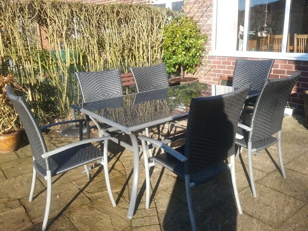 Glass topped patio table and six rattan chairs york