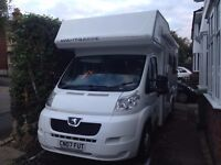 Compass Avantgarde 140 with fixed overhead double bed and large rear U-shaped lounge