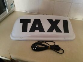 taxi car top sign