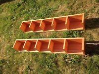 2 x wall mounted beech look shelves. Heavy, good quality, cd or paper back sized 117.5cm long.