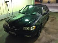 2001 Toyota Corolla 5-speed only 180k + subs and amp