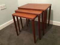 Mid century nest of teak tables.