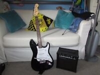C.Giant Electric Guitar with case, guitar strap and amp