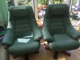 Two Leather Swivel Recliner Chairs