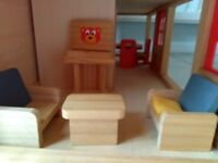 Wooden doll house with complete furniture