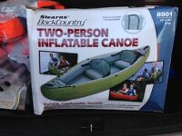 Two person inflatable canoe and accessories