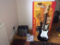 Electric Guitar Fender Stratocaster Squier with Amp, leads, DVD, original packaging. New was £300