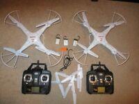 2 syma x5c Quadcopters with cameras.