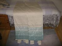A pair of lined, tap top, duck egg and cream colur next curtains, never used