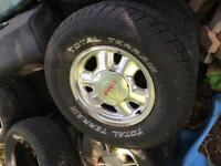 Yukon/Sierra factory rims and total terrain tires