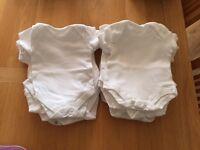 24 plain newborn vests