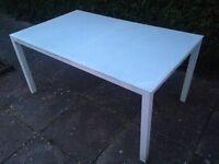 White glass top garden table