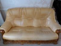 3 seat leather sofa with solid wooden base and 3 storage draws