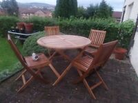 Garden furniture. ..pine table and 4 chairs bought in June for £150 selling for £85