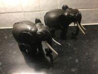 2 beautiful medium sized hard wood elephants
