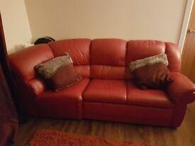 Red leather corner sofa. good condition