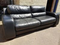 Large black leather sofa. FREE delivery in Derby