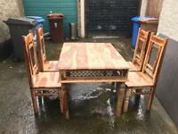 Indian rise wood dining room table and 4 chairs £145-these are very expensive new!