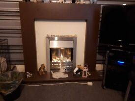 Electric firesurround and fire