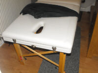 white wooden massage table