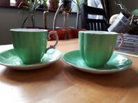 2 x royal Albert bone China cups and saucers 1 perfect the other has a crack and a chip