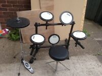 Practice drum kit with plastic hi hats and stand