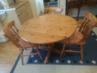 Honey Pine Round Kitchen/Dining Table and 3 Chairs
