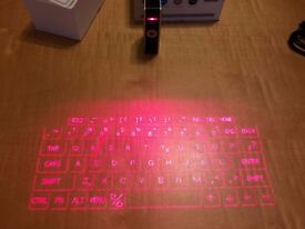 Laser projection Keyboard and multitouch mouse, Celluon Epic.