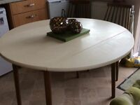 Drop leaf round kitchen table, recently renovated.