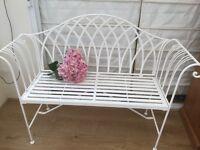 White metal garden bench