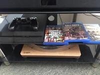 PS4 with controller and 3 games!