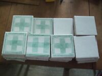 Tiles 11cms square, approx 30 white and 55 green pattern on white