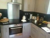 Grey framed modern kitchen with appliances