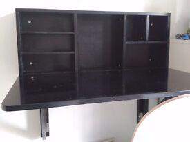 Black, wall mounted fold down desk