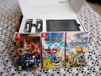 Nintendo switch new & 3 games