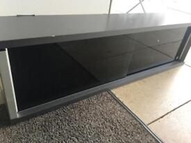 Wall shelf with glass doors