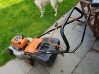 Petrol lawnmower, self propelled.