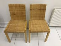 Two wicker dining chairs