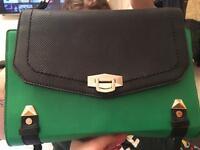 Black and green river island satchel bag