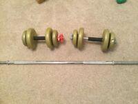 A set of dumb bells and bar