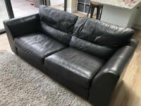 Dark brown leather three seater sofa